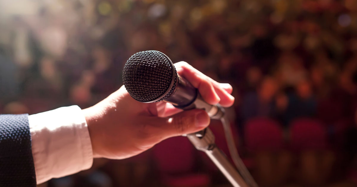 A man is holding a microphone
