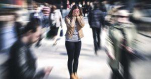 Woman having panic disorder in city.