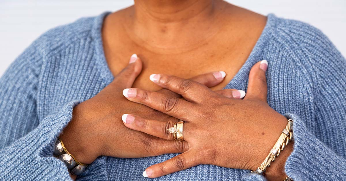 A woman is experiencing chest pain