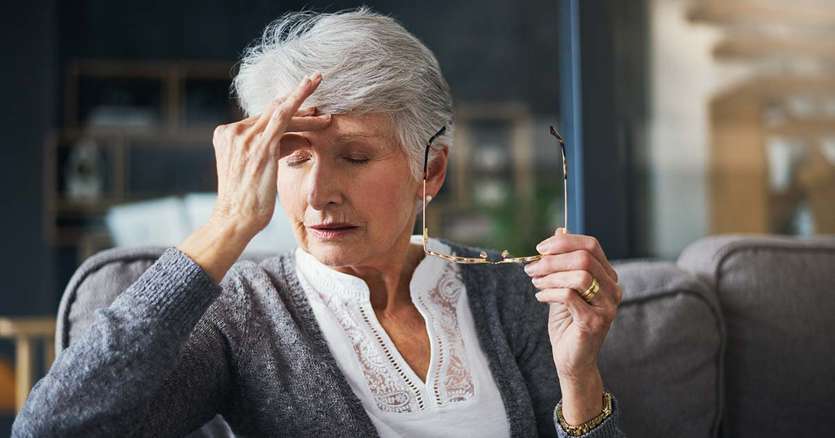 senior woman suffering from exhaustion at home