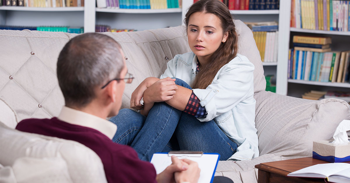 A woman is attending a therapy session