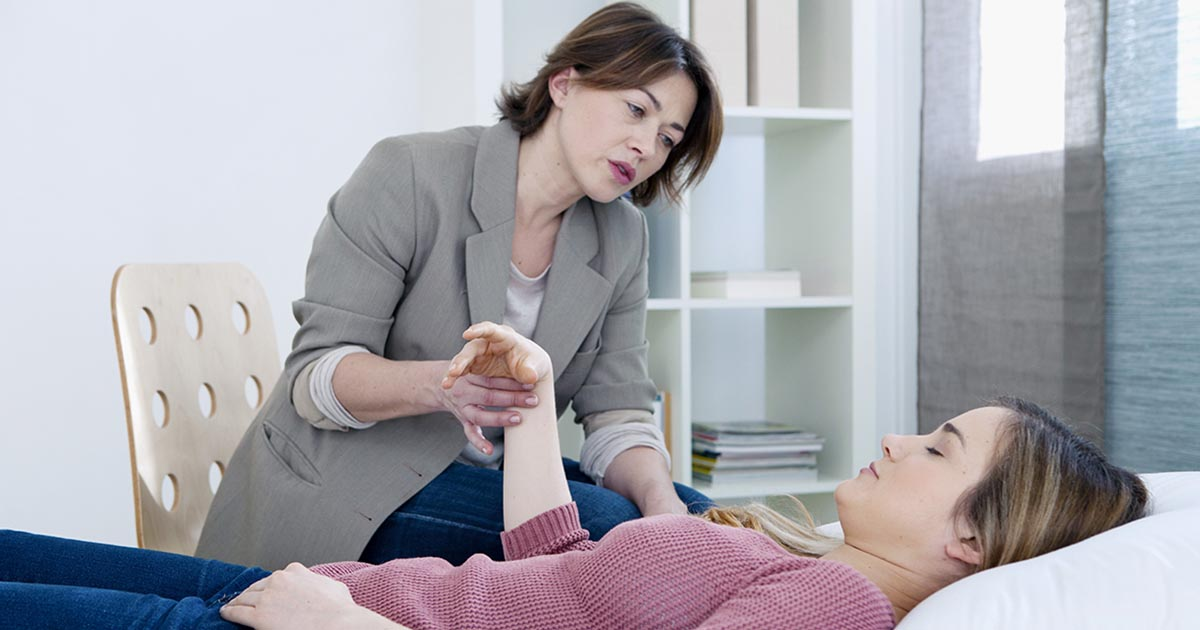 A woman receiving alternative therapy treatment