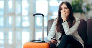 Upset girl traveling along waiting for the next flight